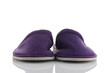 A pair of purple slippers