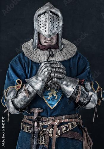 Colorless photo of knight who is praying
