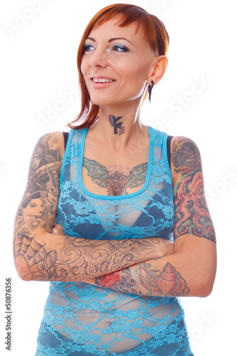 Abundance of tattooes on young female body