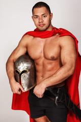 Brave warrior with helmet in his hands