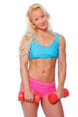 Cute fit blond woman with red dumbbells