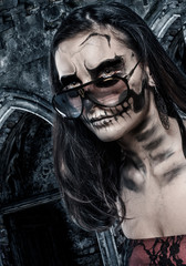 Skull faced girl on a castle background