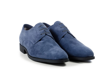 everyday pair of blue men's shoes on a white background