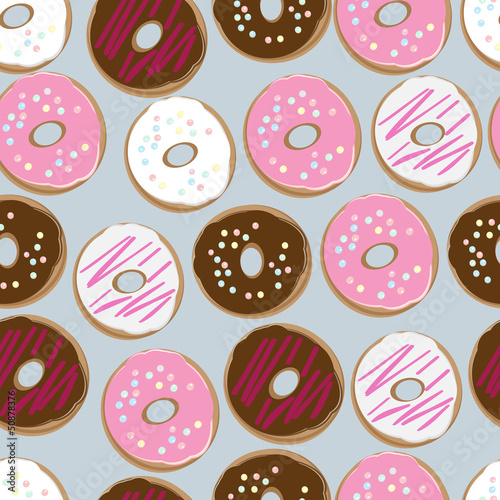 Wall mural Seamless background of assorted doughnuts