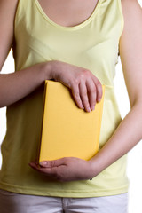 Woman holding a yellow book