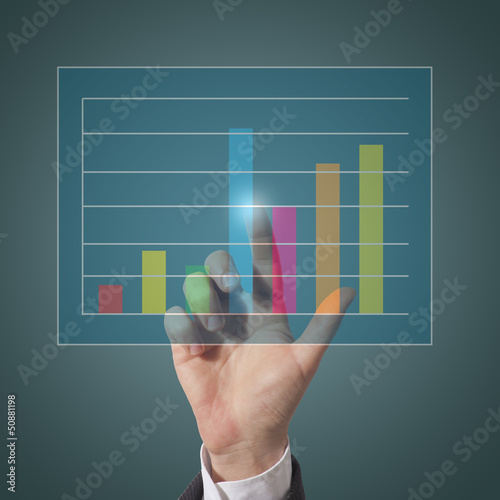 businessman touch graph