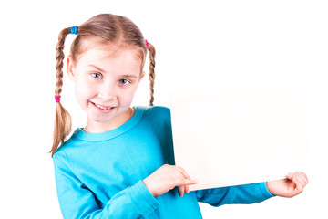 Smiling little girl holding white card for you sample text