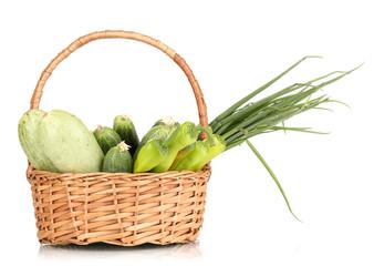 fresh green vegetables in basket isolated on white