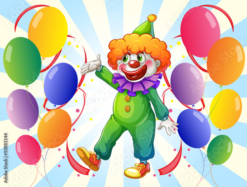 A male clown in the middle of the balloons
