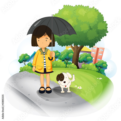 A girl with an umbrella and a puppy at the road