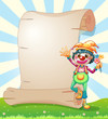 A clown with flowers beside the blank paper