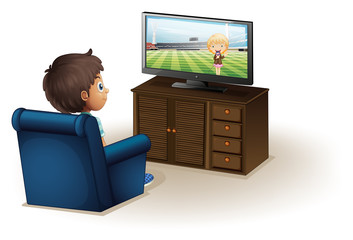 A young boy watching a television