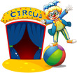 A clown at the top of the ball beside a circus house