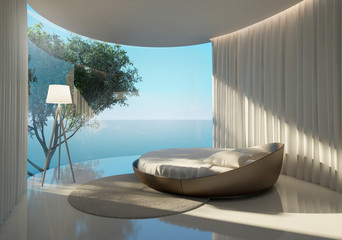Atmospheric contemporary bedroom, round bed and sea view