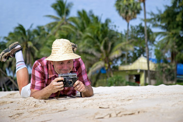 traveler photographing at the beach