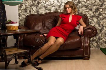 Attractive blonde in the vintage interior