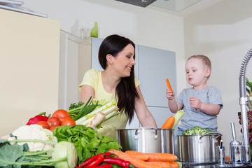 Mother and child at kitchen