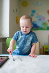 Cute boy drawning