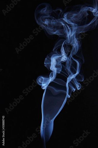 Female shape made of smoking fume
