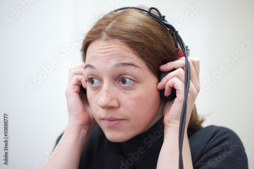 ear exam with headphones