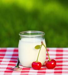 Cherry yogurt in a glass jar