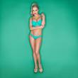 Serious Blonde Young Woman In Bikini