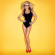 Blonde Woman In Swimsuit Wearing Eyeglasses