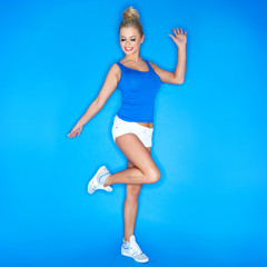 Blonde Young Woman Wearing Canvas Shoes