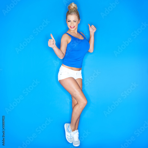 Young Woman Squinting And  Showing Thumb Up Sign