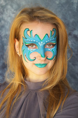Young woman with face art