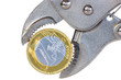 Euro coin squeezed in an  pliers
