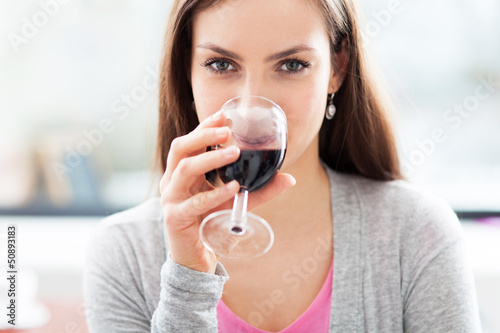 Woman having glass of wine