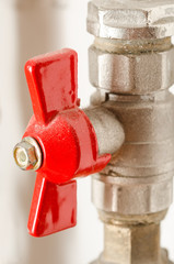 Red Faucet From A Water Pipe