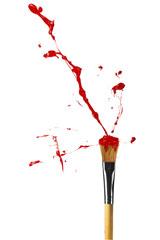 Red paint bursting from paintbrush