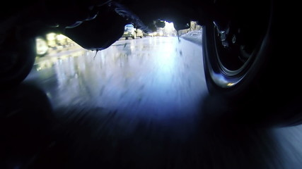 Driving through puddles. Loopable, view   under car. 1080p, vj.