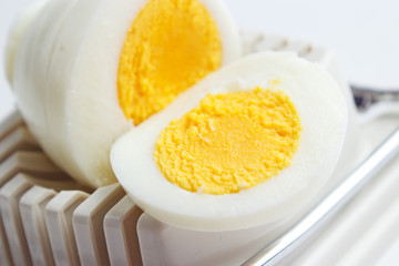 Hard boiled egg slices on slicer