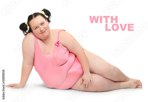 Happy overweight woman in swimsuit.