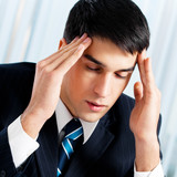 Thinking, tired or ill with headache businessman