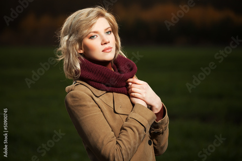 Young woman walking in autumn field