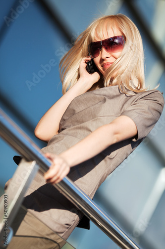 Blond woman calling on the phone