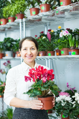 woman in flower shop with Cyclamen