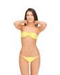 beautiful woman in bikini playing with hair