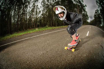 Downhill skateboarder in action