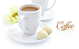 Cup of coffee with candies on white background