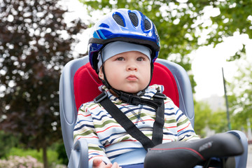 little boy with blue helmet on bicycle