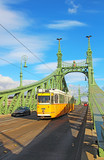 Orange tram on the Liberty bridge in Budapest, Hungary