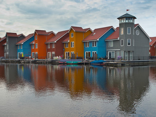 House in many color on waterfront