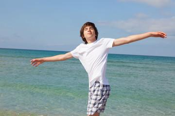 boy on a walk by the sea