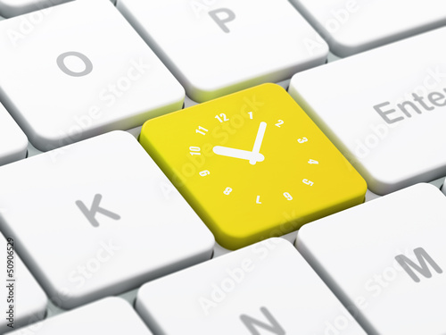 Time concept: Clock on computer keyboard background