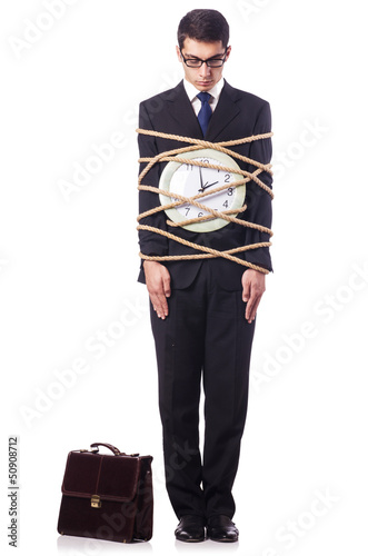 Businessman tied to clock on white